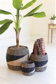 Set of three round black and natural seagrass baskets