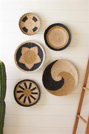 Set of five round seagrass wall art