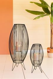 Set of two tall wire lanterns with glass hurricanes