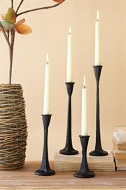Set of four cast iron taper candle holders