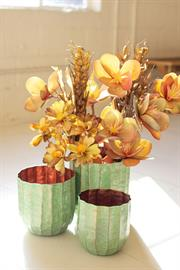 Set of three metal planters with verdigris finish