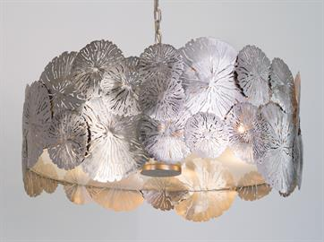 Highly-detailed lily pad leaves overlap to form this beautiful efflorescent pendant. The multi-sized nickel-plated leaves are delicately perforated to allow only small amounts of light to pass through and the overall effect is stunning. Monet would be proud. Also available in Antique Brass finish.