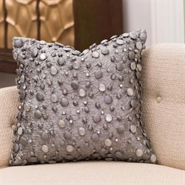 Our bejeweled pillows feature glass beads hand-covered in varying layers of a voile-like fabric. The result is three-dimensional, light-catching and eye-catching. 40% polyester, 60% nylon. Available in Bronze, Gold and Grey.