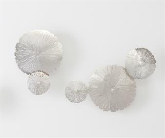 Each highly-detailed, antique nickel lily pad leaf is delicately perforated to allow only small amounts of light to pass through. A set of three includes one large, one medium and one small leaf complete with a mounting mechanism for each leaf. Use several clusters to create a multi-dimensional floral wall. Make Monet proud.