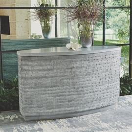 Mango wood individual shingles cover the surface of our curved console.  Rich grey wash on the wood surface compliments a grey terrazzo top.    Part of a new 3 piece collection for Studio A Home.