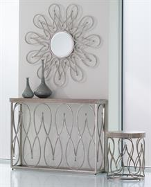Moroccan silhouettes are visible in this collection. Tables are made of textured, nickel-plated iron with white-washed mango wood tops.