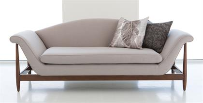 A tribute to mid-century modern style, Studio A Home's Wagner sofa appears to float on an exposed beech wood frame. The exaggerated curve of the arms rest on the vertical frame posts. The curved back and single bottom cushion add to the elegant lines of this unusual profile. Available in Linen, Charcoal and Flannel fabrics, as well as Muslin.