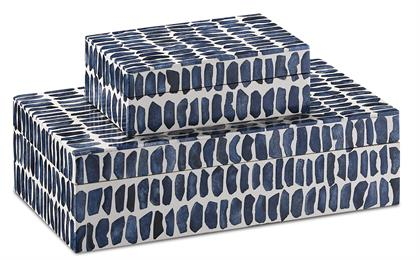 Our Indigo Box Set includes two blue and white boxes that are textural and playful. The pair of white and navy blue decorative accessories are covered in indigo blue bone and composite