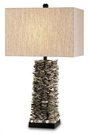 Stacked Oyster shells applied by hand to the pedestal of the Villamare Table Lamp create a textural column rising from a satin black wood base. This is one of our painstakingly hand-applied artisanal pieces. The shell table lamp is topped with an oatmeal linen shade.