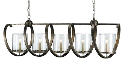 Our Maximus Bronze Chandelier has a fanciful design made of wrought iron spirals that hold beautiful seeded glass shades. The metal on the fixture in a rich Pyrite bronze finish has been mottled for a slight textural feel. There are a number of fixtures in the Maximus family.