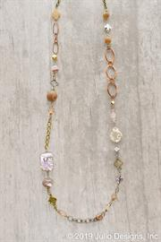 Eclectic collection of beads charms and chains in one single necklace.