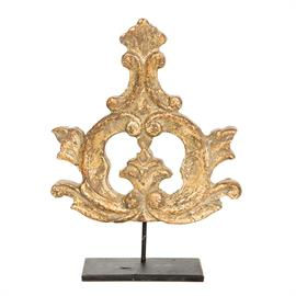 Inspired by pieces of hand carved wood tracery, once from a larger, more ornate carving, these fragments sit a top metal bases, adding a simple touch of gold to any décor.  Great for book tops or any place one needs a small display piece.