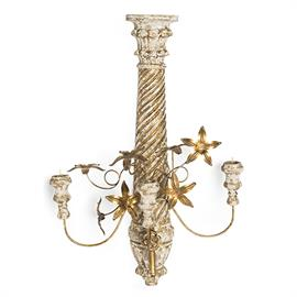 Grounded by a strong center hand carved column and adorned with moldable gold leaf flowers, this three light candle holder feels just like a found antique.