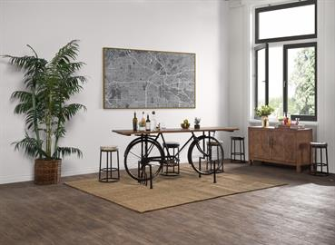 The Cycle Gathering Table is made with a reclaimed wood top and a salvaged commuter bicycle base. Commonly seen on the streets of India, this bike finds new life as a gathering table that will serve as an instant conversation piece in your space.