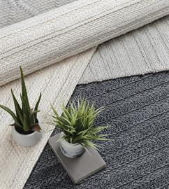 Hand braided wool and viscose blend together to create lightly textured rugs in serene colorways.