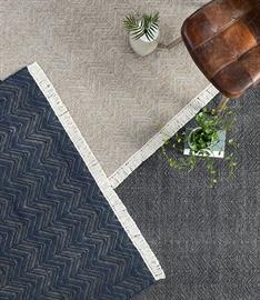 A handwoven herringbone pattern gives subtle detailing to this synthetic fiber rug. Durable enough for outdoor use, Augusta is both stylish and strong.
